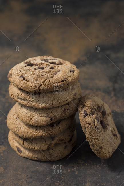 Stack of chocolate cookies on rusty metal