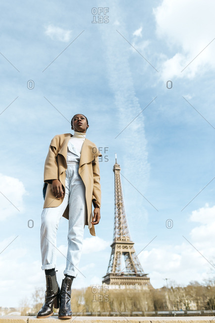 France- Paris- Woman posing with the Eiffel tower in the background