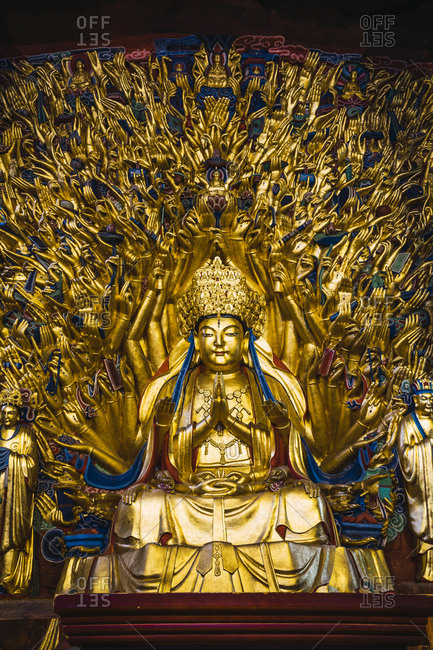 China- Sichuan Province- Dazu Rock Carvings- golden Buddha statue