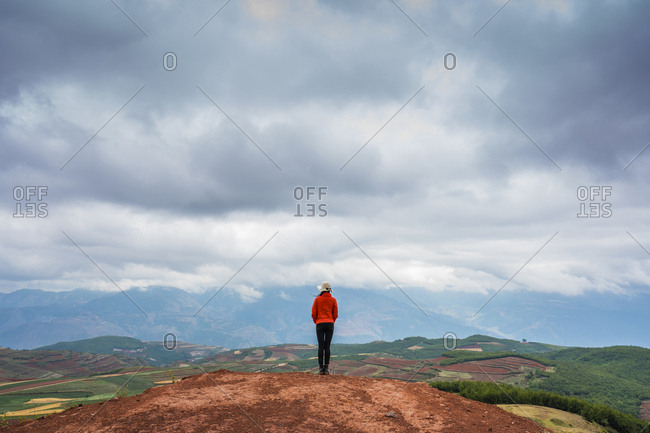 China- Yunnan province- Dongchuan- Red Land- young woman standing on viewpoint
