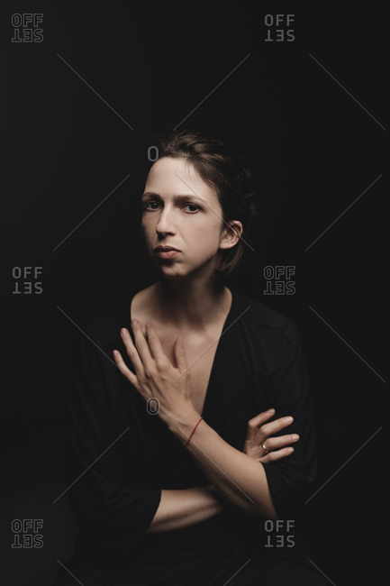 Portrait of woman in front of black background