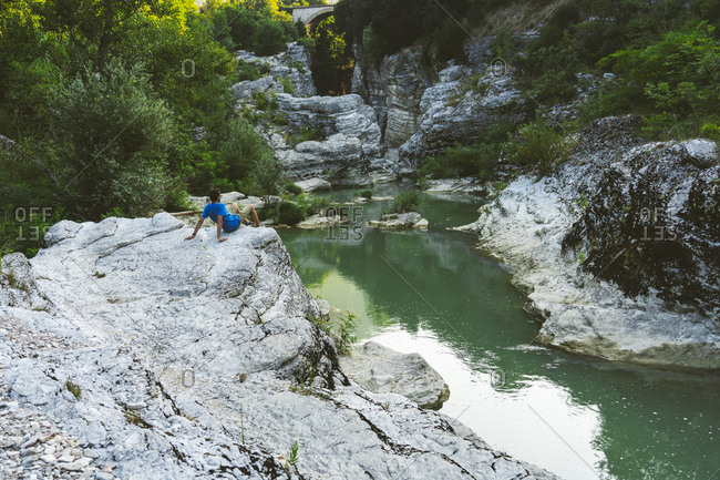 Italy- Marche- Fossombrone- Marmitte dei Giganti canyon- Metauro river- hiker sitting on riverside