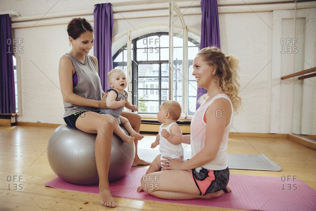 Mothers and babies in exercise room