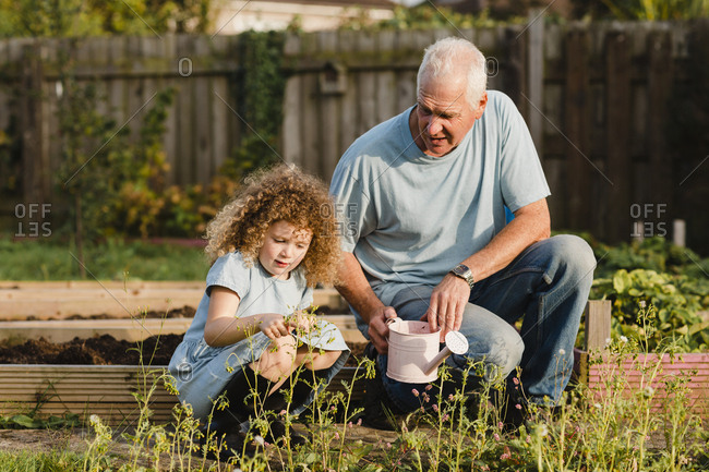 Little girl with her uncle in the garden
