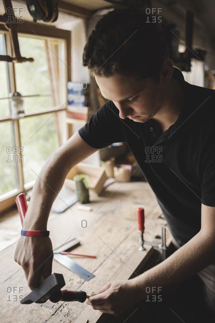 Carpenter working on piece of wood in workshop