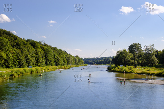 Germany- Munich- People bathing in the Isar river near Marienklause
