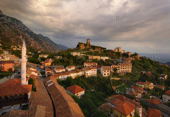 Albania- Kruje- townscape with bazaar street- Bazaar Mosque- Skanderbeg Museum and fortress at dusk