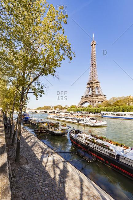 France- Paris- Eiffel Tower and tour boat on Seine river
