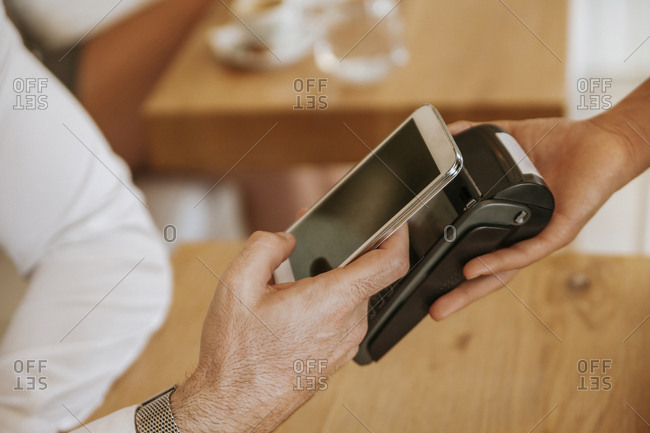 Contactless payment with smartphone in cafe