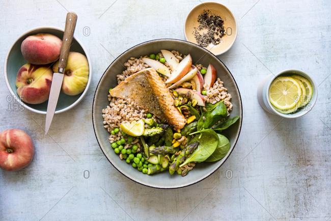 Farro salad with salmon and fresh peaches