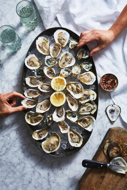 Eating large oyster dish