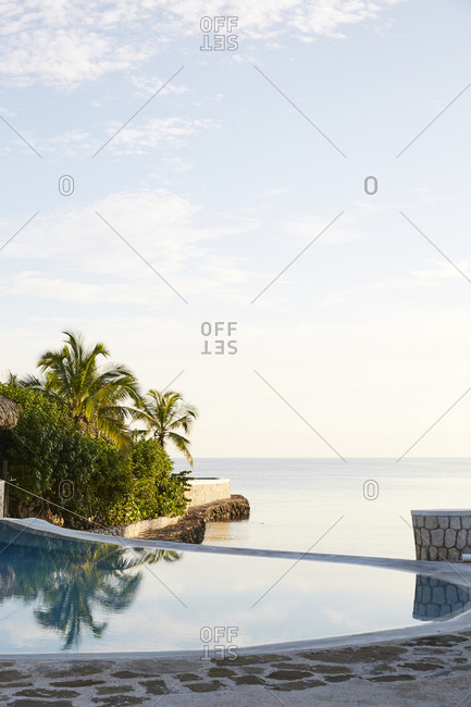 Pool on the edge of ocean in tropical destination