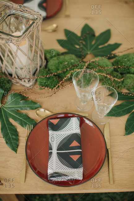 Place setting on table with green natural d�cor