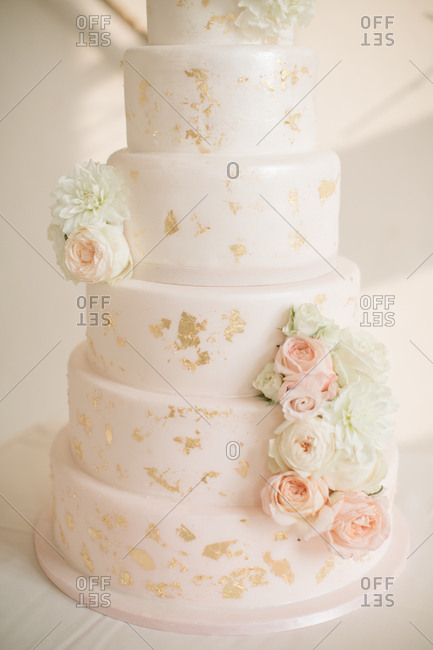 Beautiful white and gold cake with flowers
