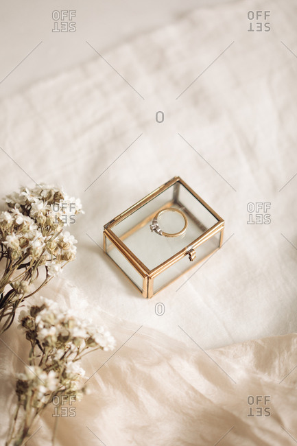 Engagement ring on a glass box