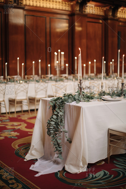 Tables with lit candles at a wedding reception