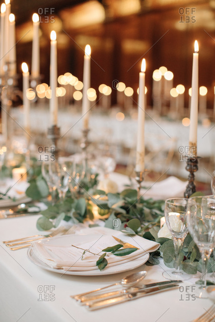 Close up of tables with lit candles at a wedding reception