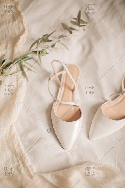 White bridal shoes on white cloth