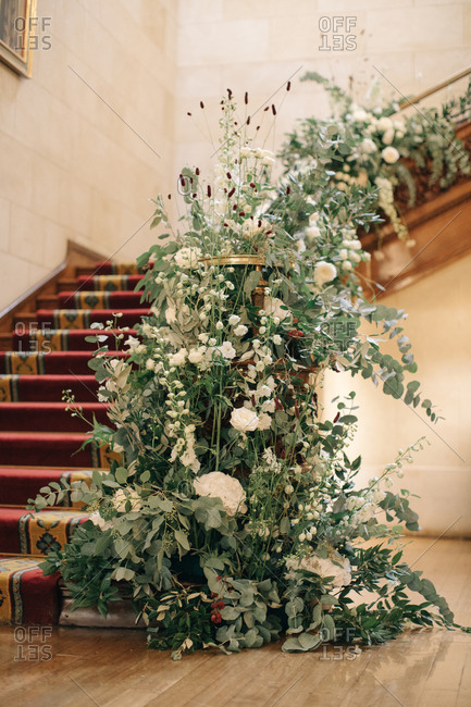Wedding floral arrangement on stair railing
