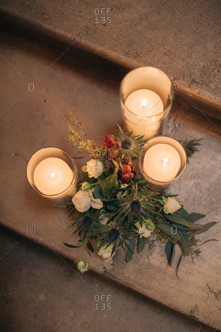 Overhead view of candle and flower arrangement