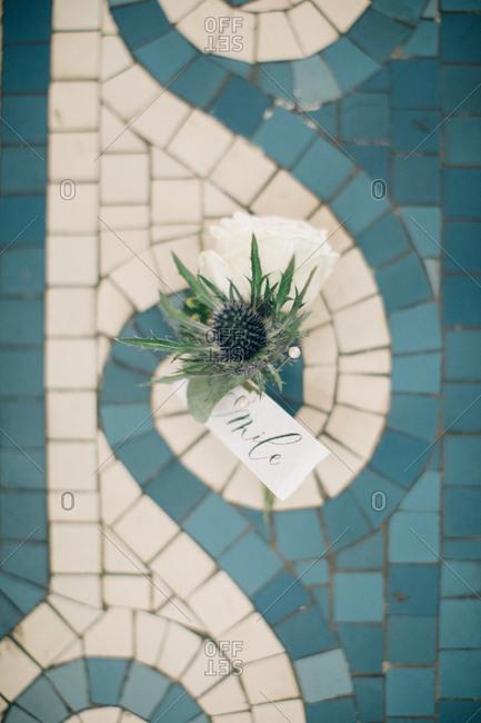 Small floral arrangement on mosaic tile