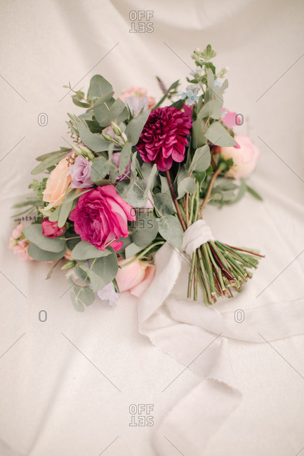 Colorful wedding bouquet on white fabric