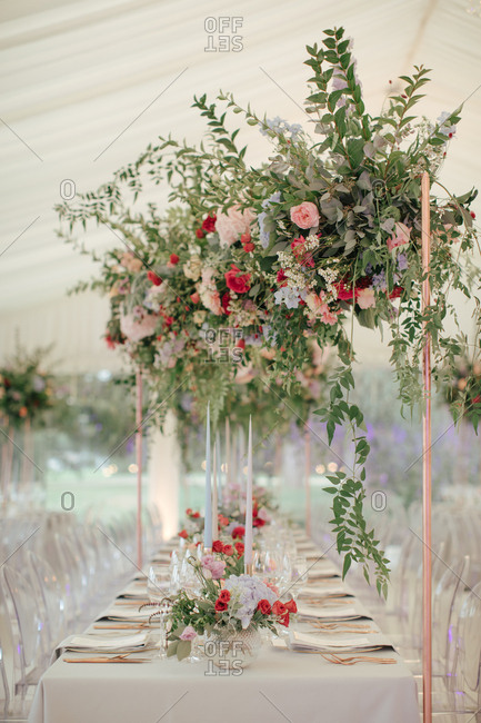 Tables with large flower arrangement at a wedding reception