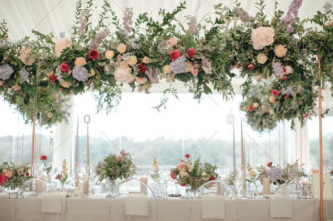 Large flower arrangement at a wedding reception in a tent