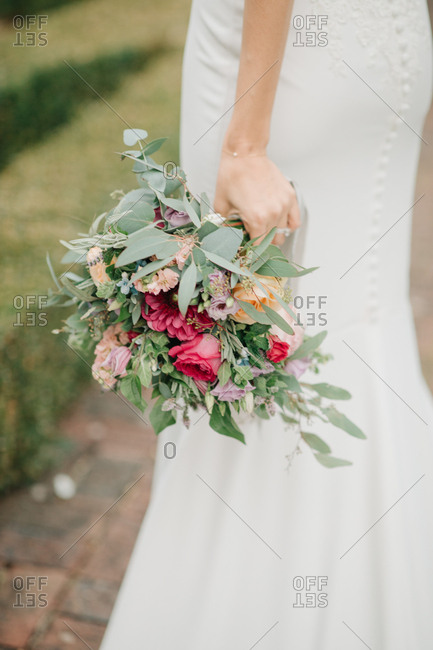 Close up of a bride holding colorful bouquet