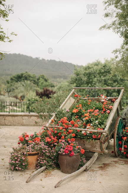 Flower arrangement in a wooden cart