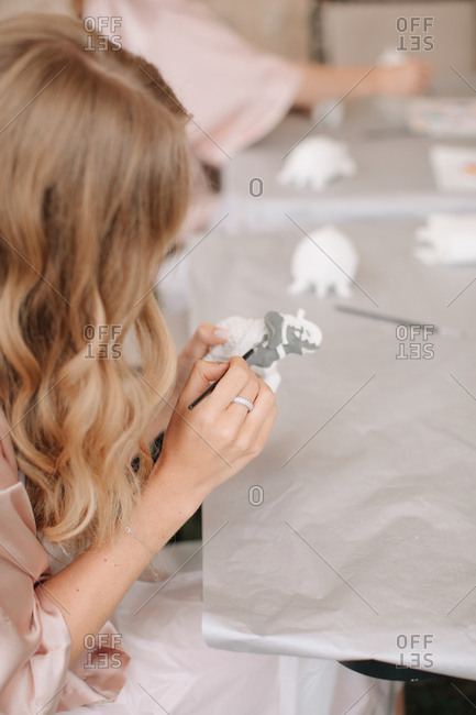 Woman painting ceramics