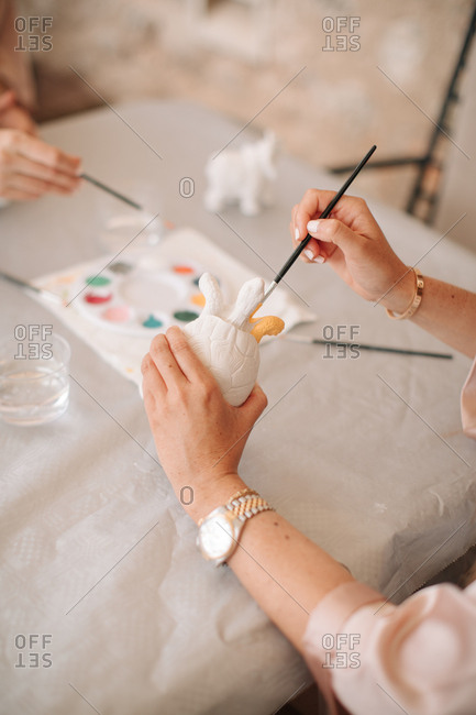 Women painting ceramics
