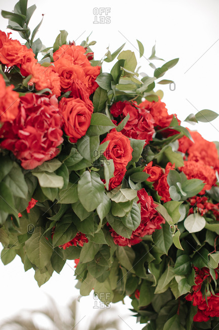 Close up of wedding arch with red flowers