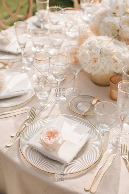 Place setting at an elegant outdoor wedding