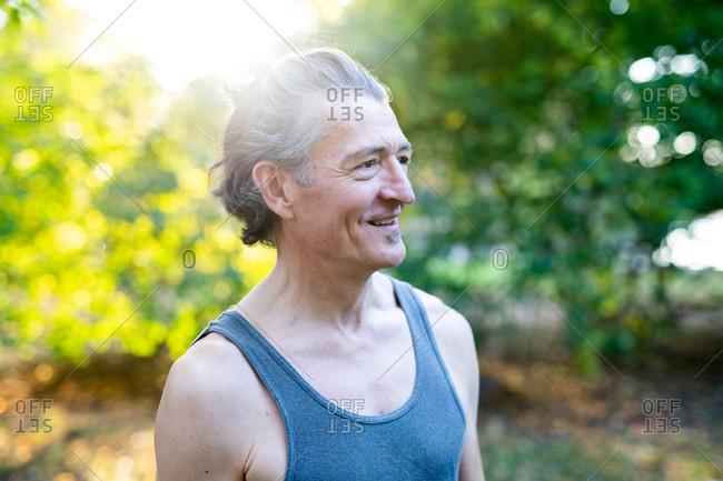 Senior man smiling in park in autumn