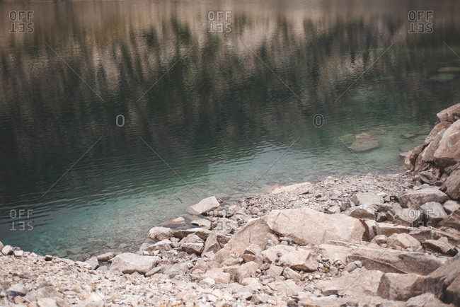 Reflection of rocky mountain in lake
