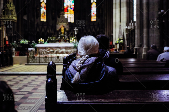 Zagreb, Croatia - October 30, 2014: People praying during a mass at Zagreb Cathedral