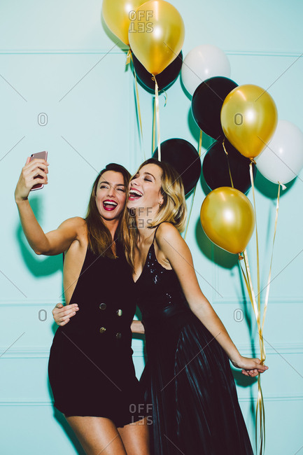 Beautiful women taking a selfie in a New Year party celebration.