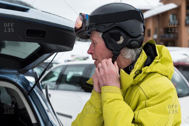 Close-up of senior man wearing ski helmet