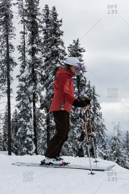 Skier skiing on snowy landscape during winter