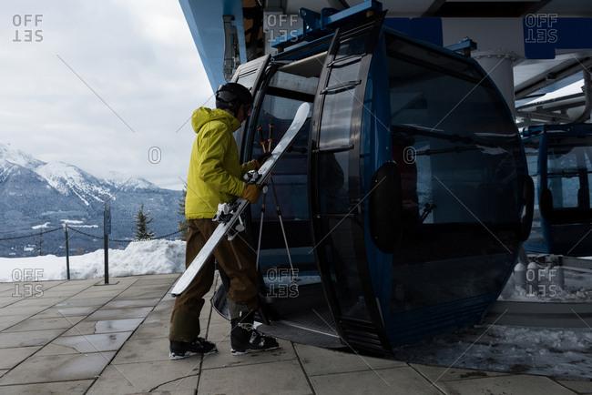 Skier entering into ski lift during winter