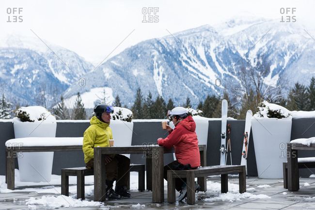 Senior couple interacting while having coffee at winter