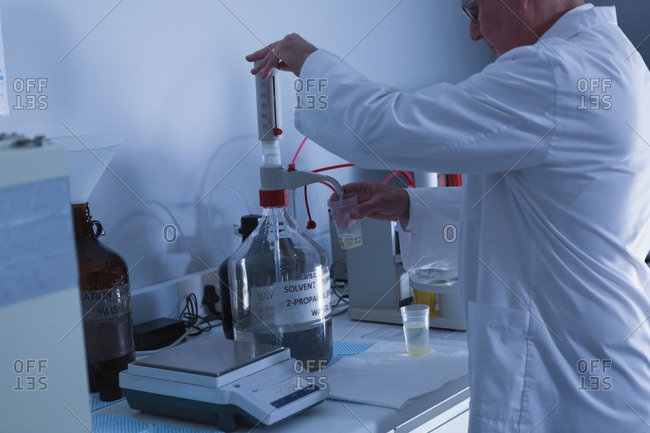 Side view of male scientist experimenting in laboratory