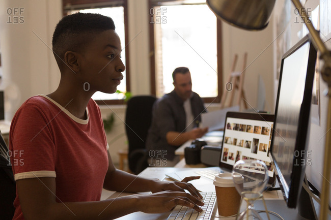 Female executive working on computer on desk in office