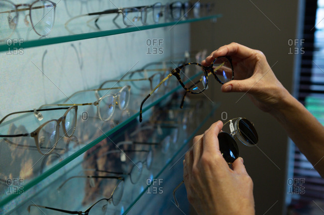 Senior woman selecting frame in clinic