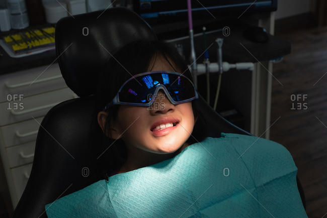 Close-up of patient lying on dental chair in clinic