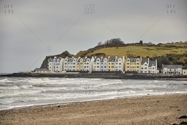 April 12, 2018: Beach with English seaside cottages, Cushendun, United Kingdom