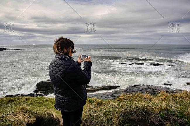 April 10, 2018: Traveler visiting Mullaghmore near classiebawn castle on overcast day, County Sligo, Republic of Ireland