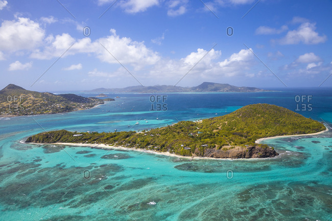 Aerial view of Petit St. Vincent, with Petite Martinique to the left and Carriacou, Grenada in the distance, The Grenadines, St. Vincent and The Grenadines, West Indies, Caribbean, Central America