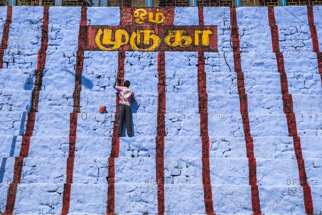 November 17, 2017: Repainting Sri Subramaniya Swamy Hindu Temple blue, Munnar, Western Ghats Mountains, Kerala, India, Asia